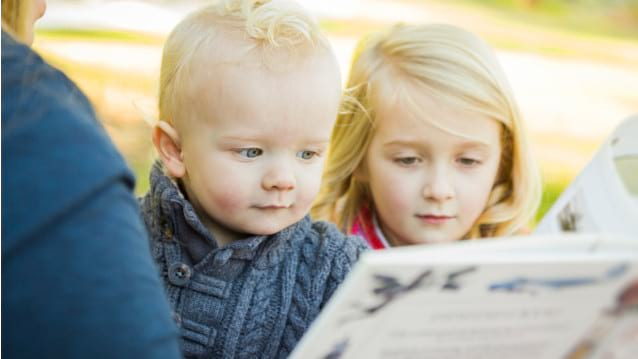 Image of two young children reading