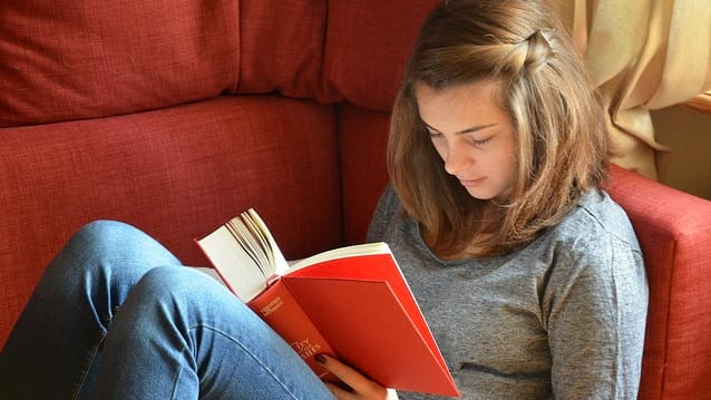 Image of teenage girl reading